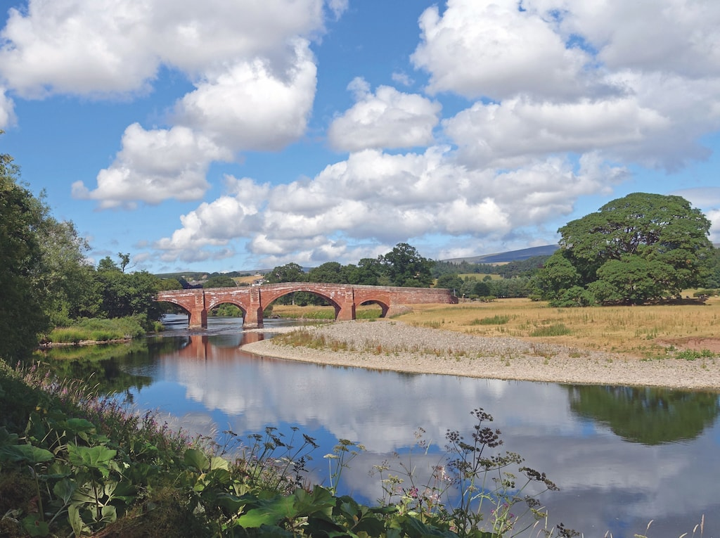 The red stone arches of Eden Bridge, Lazonby,  by John Shepley, of Penrith.