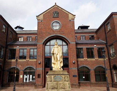 """A former police constable ran a """"professional"""" cannabis factory protected by strategically placed weapons from his Eden village home near a school, Carlisle Crown Court heard."""