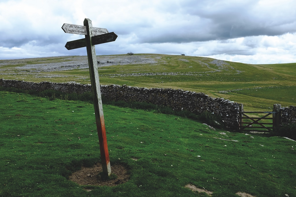 A signpost points the way on Orton Scar in this shot by Simon Cove.