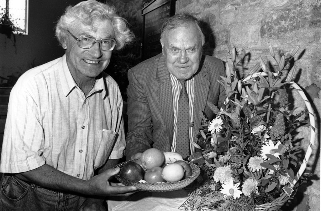 Dr. Frank Rogers and sidesman Edgar Waugh get a taste of Nenthead WI's display at the celebrations held to mark the 150th anniversary of the church of St. John the Evangelist, Nenthead.