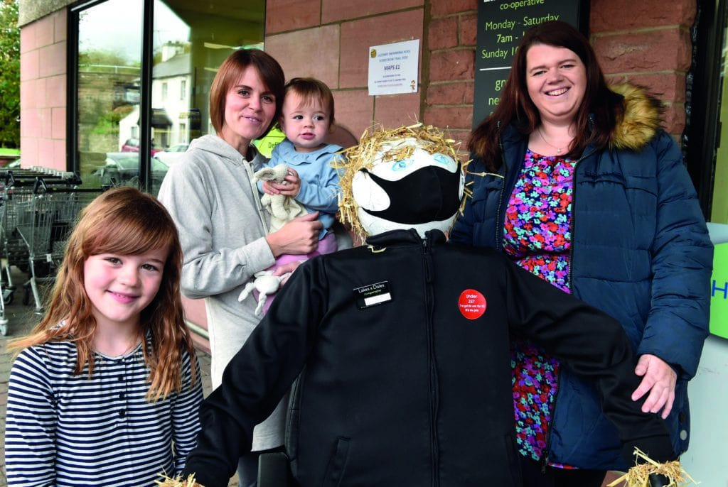Organiser of the scarecrow event Josie  Foster far right with the coop worker scarecrow and the Rayson family of Renwick..Sophia,Kate and Mimi.