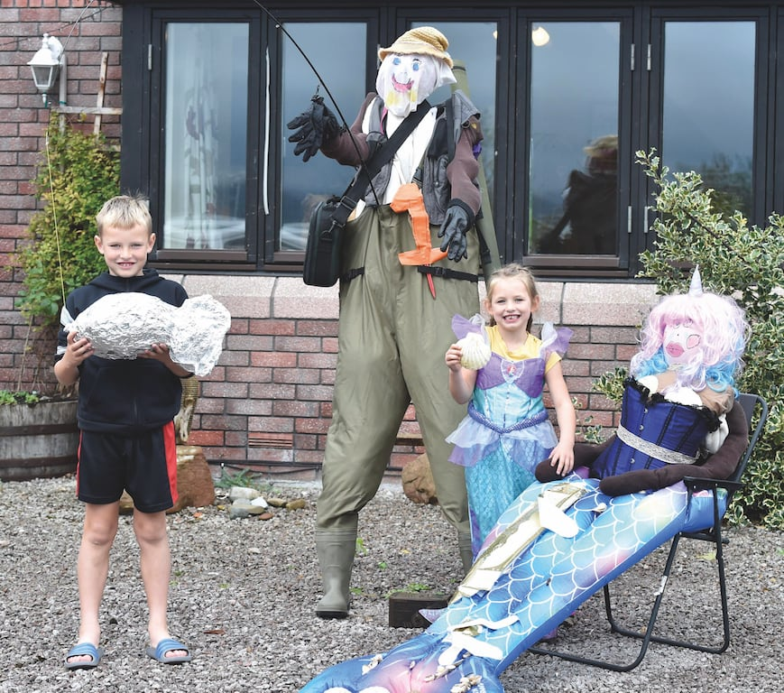 Oliver and Maisie Grainger with their scarecrows called The fisherman who caught the mermaid.