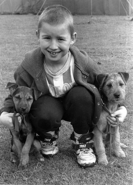 Nine-year-old Bryan Jolly, Penrith, at a terrier and lurcher show held at Wet Sleddale Park, Shap, with his four-month-old Border Lakeland terriers.