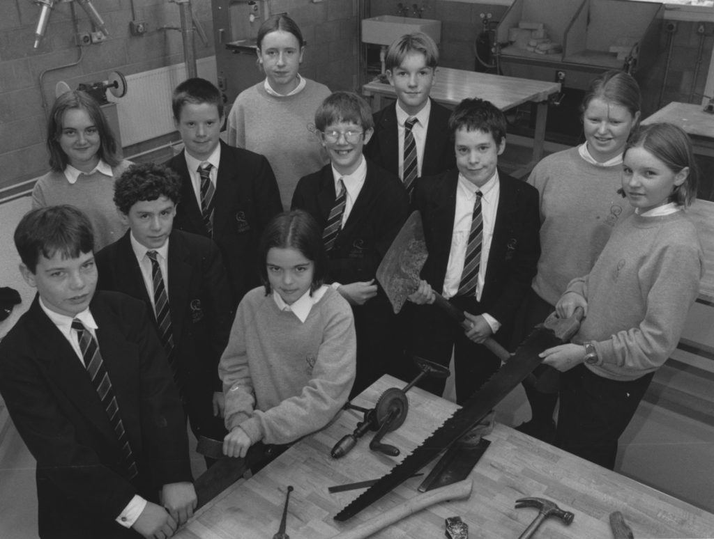 Year eight pupils at Penrith's Queen Elizabeth Grammar School with tools they were renovating and sending out to building students in Africa 25 years ago.