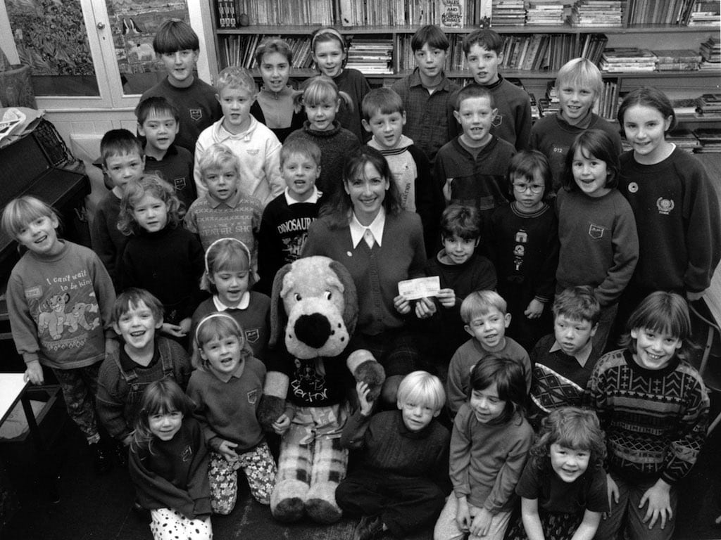 Temple Sowerby School pupils donated £150 to Help the Aged from money raised at their harvest festival in 1995. All 30 pupils at the school are pictured presenting the money to the charity's fundraising officer, Julie Joseph, and canine mascot Hector.