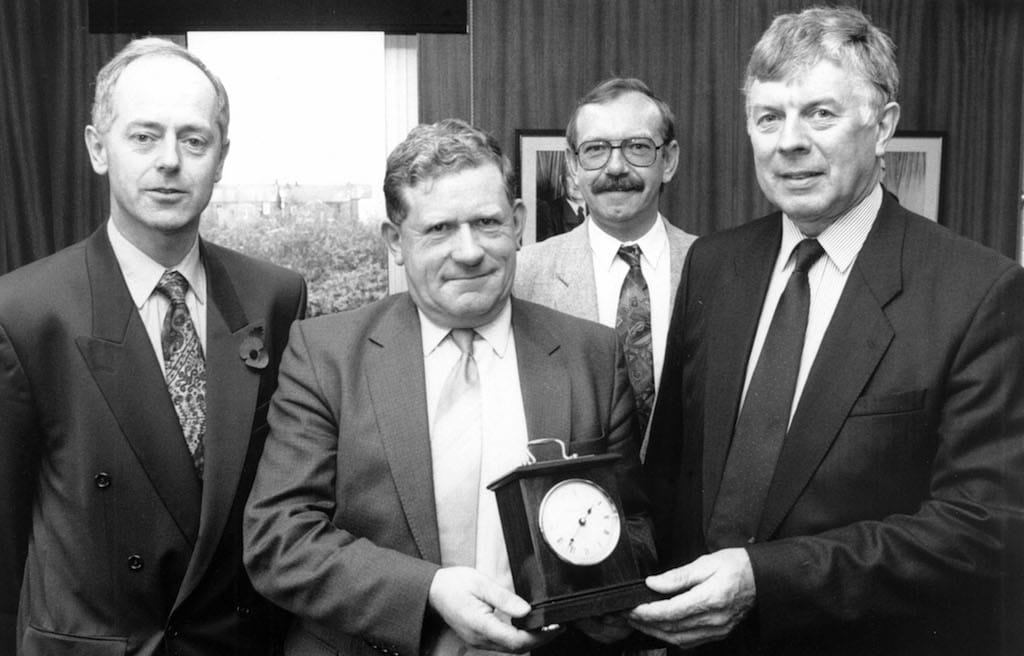 Pictured at a presentation ceremony held in 1995 (left to right) are Steven Clark, operations director of AF Penrith; Willie Hastwell and John Burns, who received awards in recognition of the fact both had completed 25 years of service with the firm; and Bryan Carr, chairman of AF Cumbria.