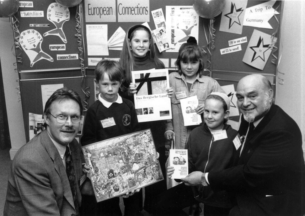 Dr Jurgen Kroneberg (left) announced the winners of a competition organised 25 years ago by Cumbria County Council's library service and based around the twinning with the German region of Rheinisch Bergischer. He is pictured at Penrith library with winners James Tweedie, Katy Forrester, Amanda Tinkler and Jenny Cornwell, and county council chairman Colin Liversedge.