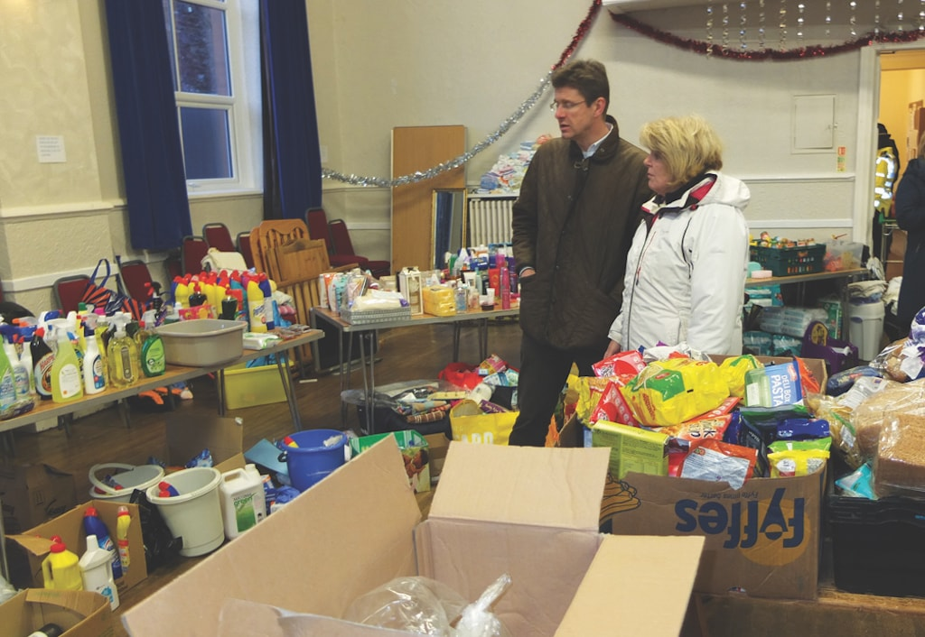 Greg Clark is shown donations from the public by Jackie Kirkpatrick, president of Appleby Chamber of Trade.
