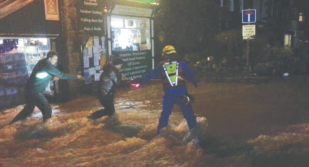 Glenridding residents are helped to safety as flooding struck for the second time