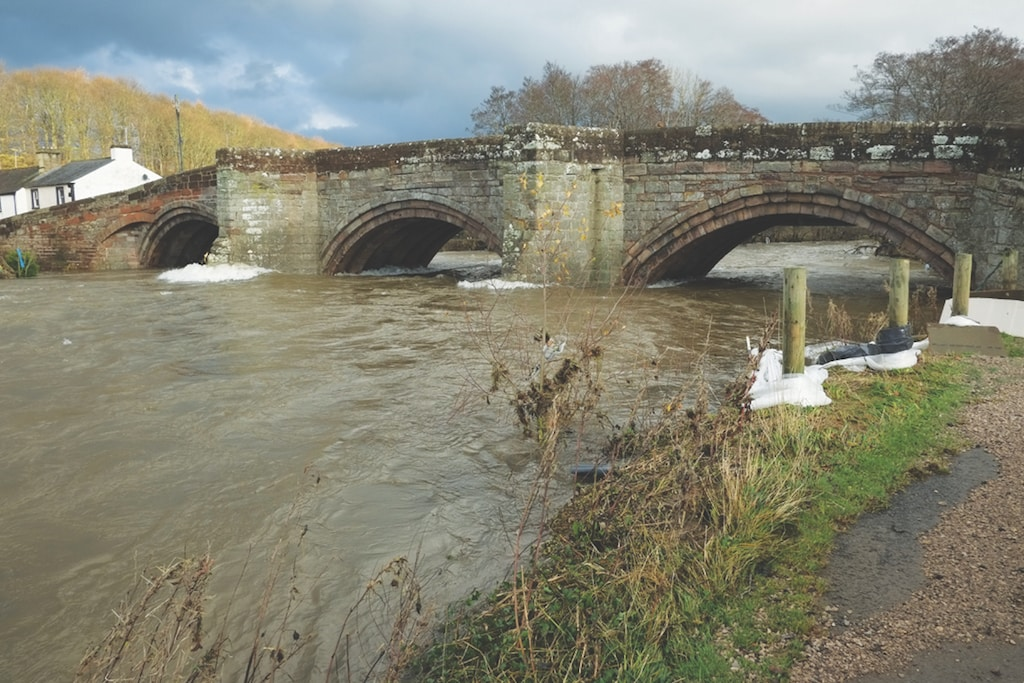 The bridge over the River Eamont on Monday morning when water levels were still almost as high as the riverbank. There are concerns over the bridge's stability.