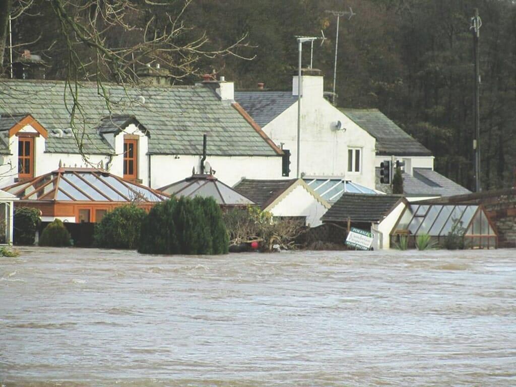 The river engulfs houses in Skirsgill Lane, Eamont Bridge.