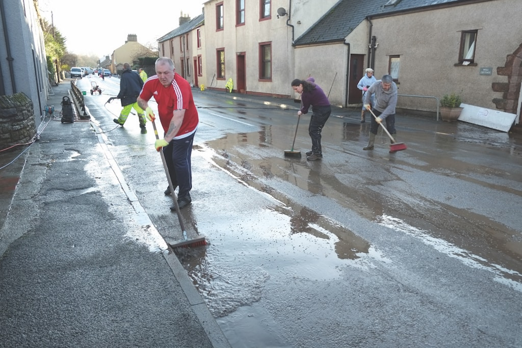 Villagers from Eamont Bridge and the surrounding area rally round to clear up the mess left behind by the weekend's flood which residents said was worse than the one in 2009