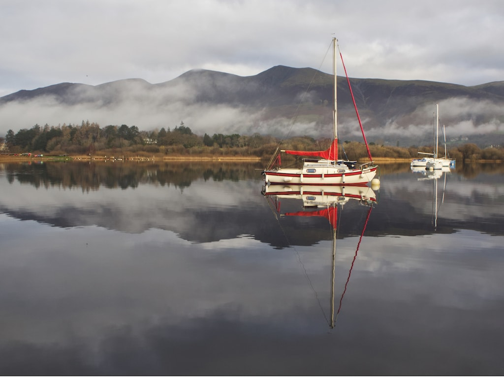 Reflections on the surface of Derwentwater and a lone boat can be seen in this lovely shot by George Parkinson, of Keswick.