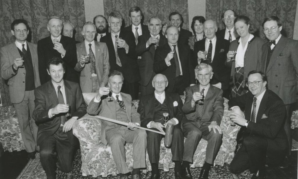 Glasses are raised at a dinner held to celebrate the 85th birthday of Canon Gervase Markham, Morland, and to thank those who, for 28 years, had played croquet at Morland House for a trophy which he gave.