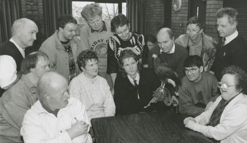 Falconer Chris Stimpson shows members of Penrith's Edington Centre a North American Harris hawk during a visit there by staff from the Lakeland Bird of Prey Centre, Lowther, in 1996.