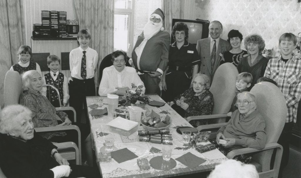 Father Christmas (Dr Hugh Barr) and Penrith Hospital patients and visitors about to enjoy some festive fare.