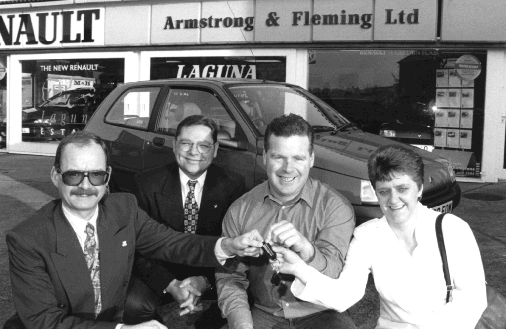 Penrithians Alan Proudfoot and his wife Susan receive the keys for a Renault Clio car he won 25 years ago in a national competition from Stephen Fleming, of Renault dealers Armstrong and Fleming, and Geoff Milne, area operations manager with Renault.