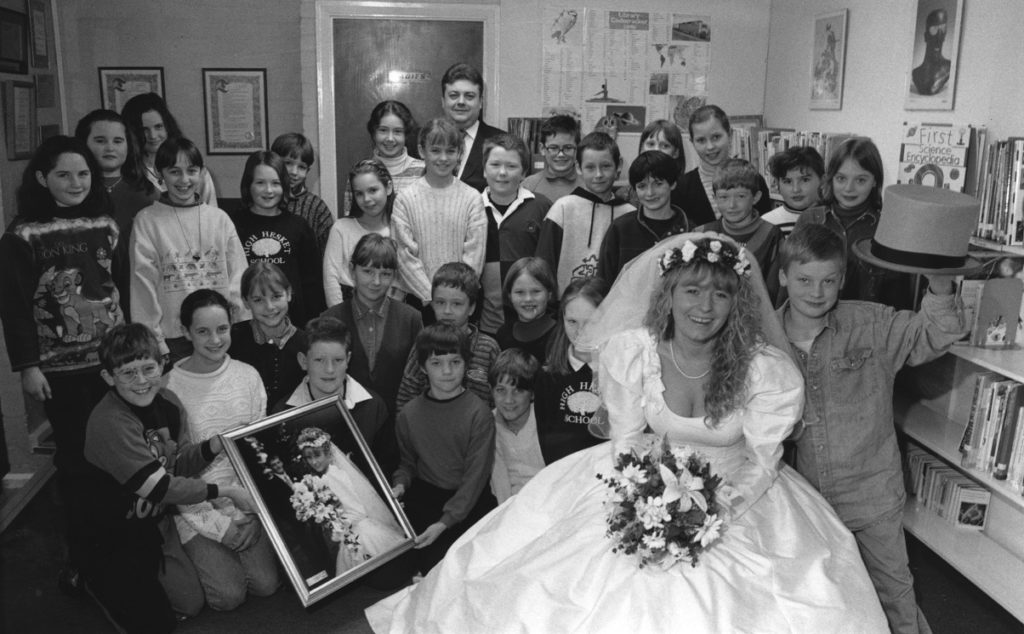 Cumbria's bride of the year in 1996, Michelle Tait, of Carlisle, visited High Hesket School at the invitation of the children to help with an art project. Michelle is pictured with some of the children and also Russell Smith, of Russell's Wedding Services, Penrith.