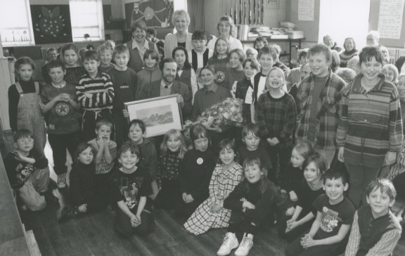 Pupils at Nenthead School present headmaster Peter Lanham and his wife with gifts to mark his retirement in 1996.
