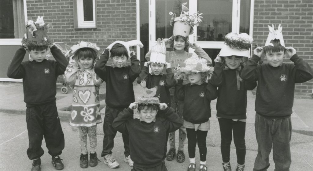 Youngsters at Long Marton School model some of their handiwork during a parade of Easter bonnets in 1996.