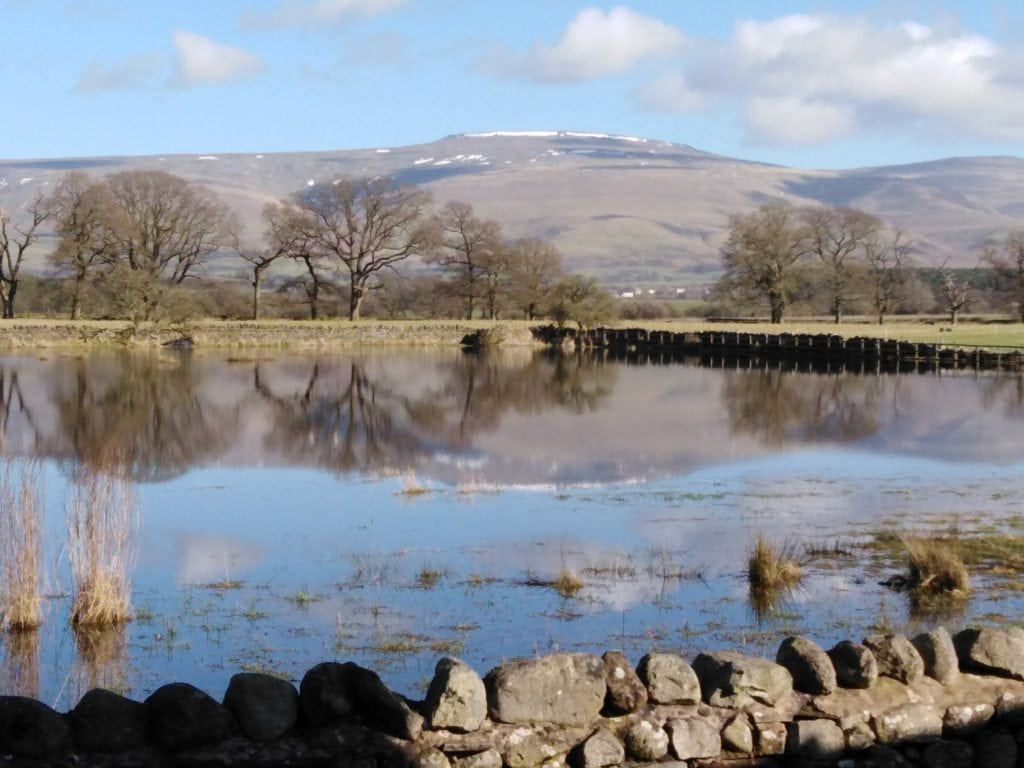 A centenary pilgrimage is to be held on a Cumbrian mountain to mark the 100th birthday of a man who has been nominated to be Zimbabwe's first saint.  Pictured is Cross Fell with the tarn at Culgaith in the foreground