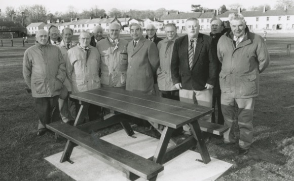 Members of Appleby's VE and VJ committee with an oak picnic seat unveiled at Broad Close 25 years ago to commemorate the anniversaries of the two dates. Pictured (left to right) are Jack Simpson, Mike Langan, Keith Laughlin, Mack Pattison, Jack Steadman, chairman Frank Graves, mayor Norman Mennie, Thomas Park, Gordon Walton, Hughie Potts, Eddie Robertson and George Cowards.