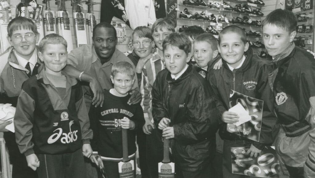 Children who met West Indian batsman Brian Lara when he visited Penrith's Sportscraft store 25 years ago.