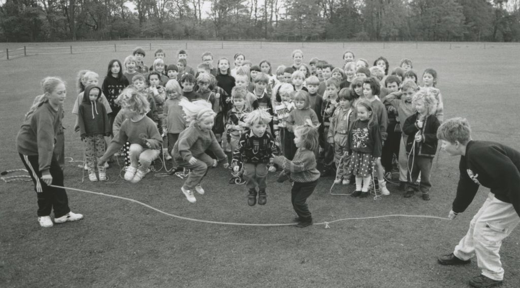 Pupils jump high during a sponsored skip held at Kirkoswald Primary School in 1996.