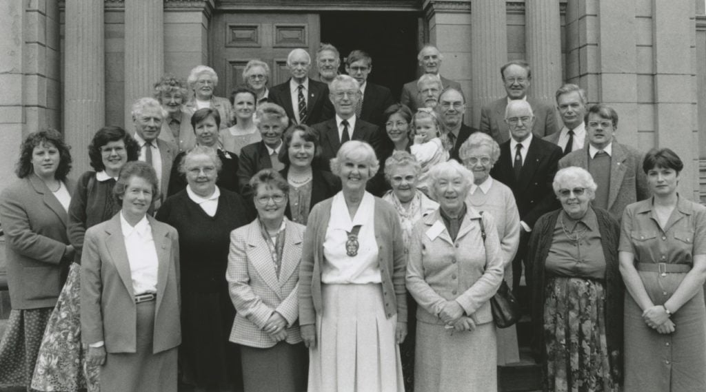 Nancy Walker, deputy chairman of Eden District council with members of voluntary groups who attended a coffee morning at the town hall 25 years ago, as part of Volunteers' Week.