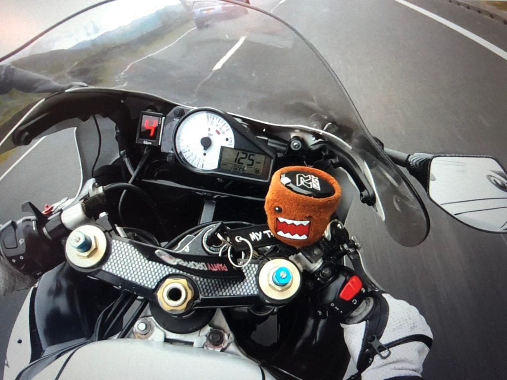 Aaron Luck's bike, showing 125mph on the speedometer