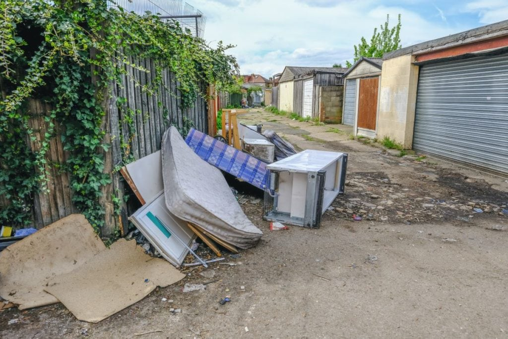 Flytipped items in a back lane